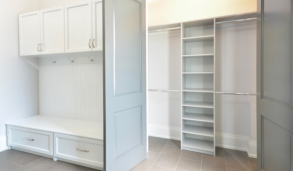 white storage entryway and mudroom